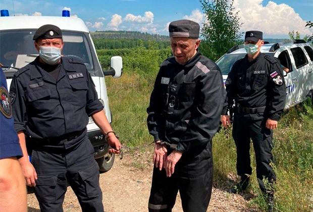 Михаил Попков на следственном эксперименте в 2020 году